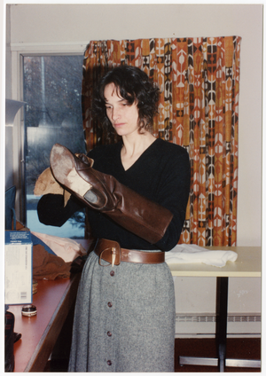 Low-input Sustainable Agriculture seminar: unidentified woman polishing boots, linking to the digital object
