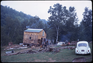 Johnson Pasture Commune: Front of the house, Volkswagen beetle, linking to the digital object
