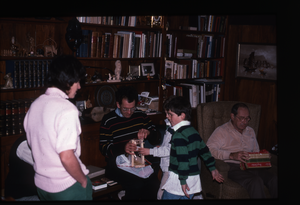 Wendell Farm: Dan Keller(?) and children opening Christmas presents, linking to the digital object