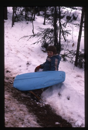 Wendell Farm: Keller son with sled