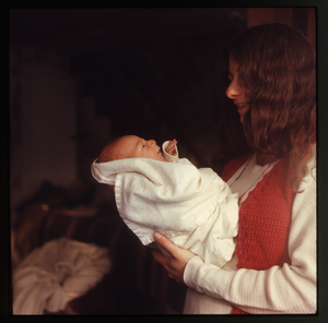 Montague Farm: Nina Keller standing, holding baby (Eben), linking to the digital object