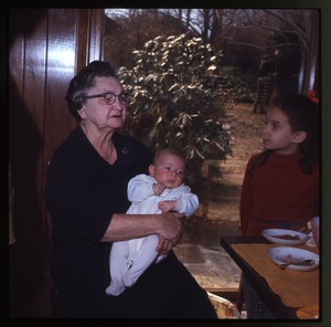 Montague Farm: Grandmother(?) holding baby (Eben) at table.
