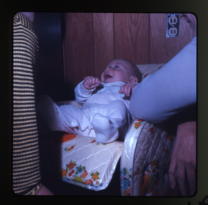 Montague Farm: Baby (Eben) in baby seat, laughing, linking to the digital object