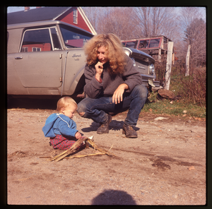 Montague Farm: Chuck Light and baby in front of car (Scout), linking to the digital object