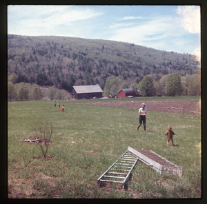 Montague Farm: Nina Keller's mother and baby (Eben?) in field above Montague farm, looking south over house and barn.