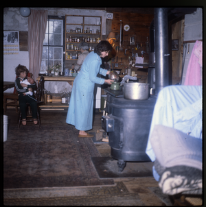 Wendell Farm: Nina Keller and kids in kitchen, linking to the digital object