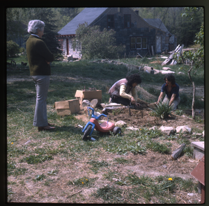 Wendell Farm: Nina Keller and unidentified planting (perennials), mother looking on, Wendell