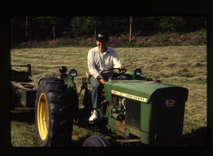Wendell Farm: Dan on tractor, Wendell(?)