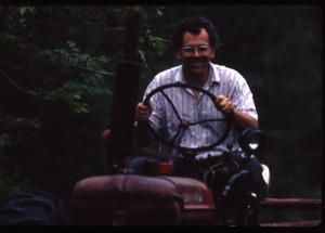Wendell Farm: Dan driving tractor, Wendell(?)