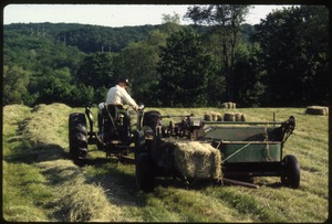 Wendell Farm: Dan on tractor, baling hay, Wendell(?)
