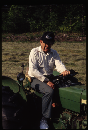 Wendell Farm: Dan on John Deere tractor, Wendell(?), linking to the digital object
