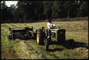 Wendell Farm: Dan driving John Deere tractor, baling hay, Wendell(?)