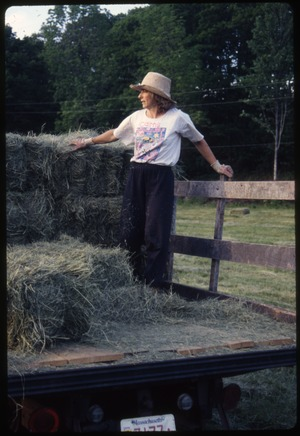 Wendell Farm: Nina on hay truck, Wendell(?)