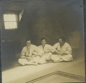 [Prof. Yamashita seated between unidentified Americans]