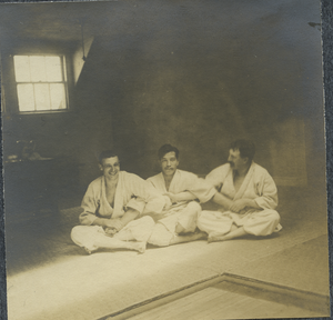 [Prof. Yamashita seated between unidentified Americans], linking to the digital object
