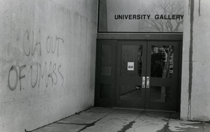 Graffiti on wall outside University Gallery reading 'CIA out of UMass', linking to the digital object
