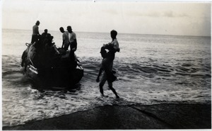 Where there are no wharves or piers passengers have to be carried through the surf like cargo by one of the boat men.