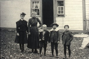Children posed in front of house (close-up), Wendell, Mass.