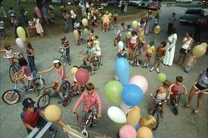 Wendell (Mass.) Bicentennial Celebration: overhead shot of children on bicycles, balloons