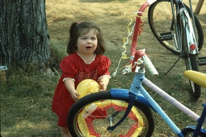 Wendell (Mass.) Bicentennial Celebration: young girl standing by decorated bicycles