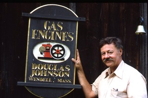 Wendell (Mass.) Bicentennial Celebration: Douglas Johnson posed with sign for his Gas Engines shop