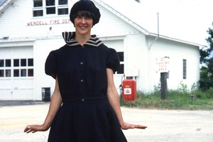 Wendell (Mass.) Bicentennial Celebration: woman standing in front of Wendell Fire Department, wearing 1920s style costume