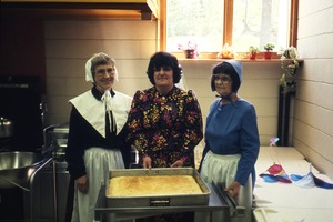 Wendell (Mass.) Bicentennial Celebration: three women (two dressed in antique costumes) in kitchen, Swift River School