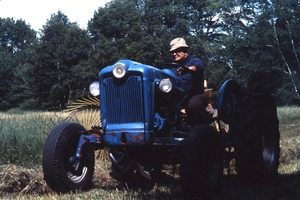 Wendell (Mass.) Bicentennial Celebration: man on a tractor, haying