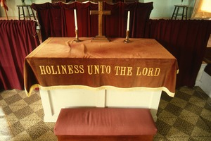 "Wendell (Mass.) Bicentennial Celebration: altar, Congregational Church with drape reading ""Holiness unto the Lord"""