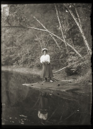 Woman fishing in a pond (Greenwich, Mass.)