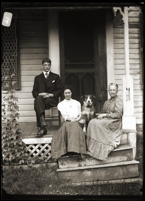 Young couple, dog, and elderly women seated on steps of a house (Greenwich, Mass.)