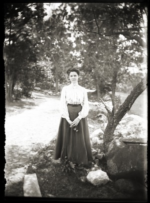 Young woman standing by tree (Greenwich, Mass.)