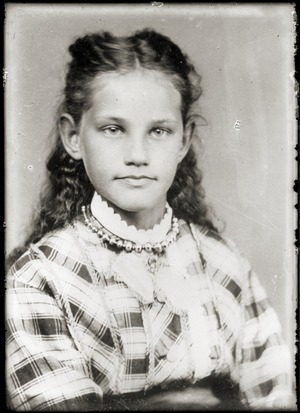 Portrait of a young girl in plaid dress (Greenwich, Mass.)