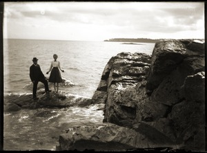 Man and woman on a rocky coast