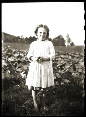 Barefoot girl standing in field (Greenwich, Mass.)