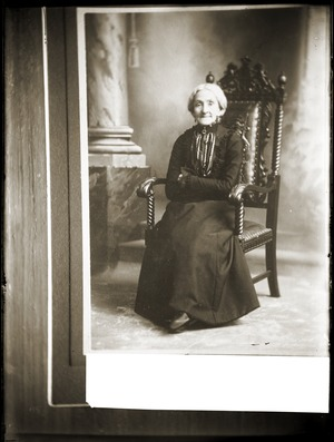 Portrait of elderly woman in chair (Greenwich, Mass.)