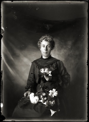 Portrait of a young woman with flowers (Greenwich, Mass.)