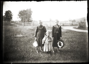 Portrait of three children in a field (Greenwich, Mass.)