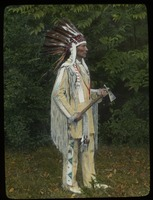 First page of Charles A. Eastman (Ohiyesa) in native dress, eagle-feather bonnet, with hatchet