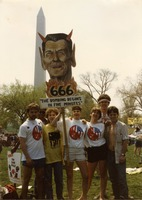 First page of UMass Peacemakers contingent at the 'Four Days in April' demonstration in Washington D.C., holding image             of Ronald Reagan with devil's horns and caption '666 The bombing begins in five minutes'