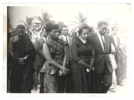 First page of Unidentified minister of the Ghanaian government escorting Shirley Graham Du Bois at the state funeral for W. E.         B. Du Bois