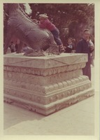 First page of Child climbing on a bronze qilin at the Summer Palace in Beijing, China