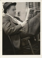 First page of Photograph of Don Sullivan leaning back in a chair, reading