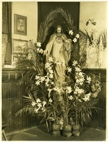 First page of Chapel of the Comforter, Greenwich Village Statue of Jesus of the Sacred Heart in a corner behind potted palms