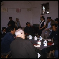 First page of Beijing District Cadre school Group of visitors and teachers seated around a table