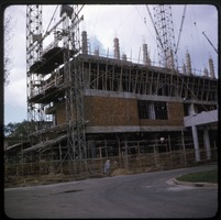 First page of Construction at Fair site Scaffolding on the exterior of a brick building under construction