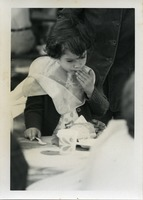 First page of Little girl in a bib, eating at the picnic, Pine Beach