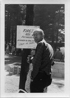 First page of Man standing by a sign 'Fires are permissible, authorized by Athol FIre             Department,' Pine Beach