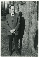 First page of Sidney Lipshires standing in front of a tree on the Manchester Community College             campus