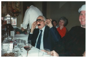 First page of Sidney Lipshires at Congress of Connecticut Community Colleges Christmas party, wearing Groucho             glasses